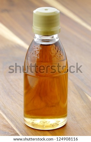 delicious grade A light amber maple syrup, with a delicate maple bouquet. - stock photo