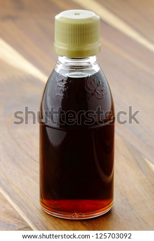 delicious grade B maple syrup, the darkest color gives it a strong maple bouquet - stock photo