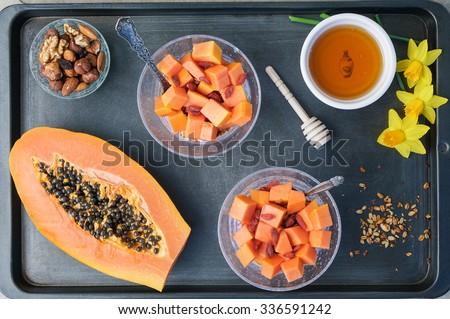 Delicious Granola with Papaya, Honey, Goji Berries and Nuts  - stock photo