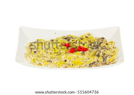 delicious green tagliatelle  on  white background