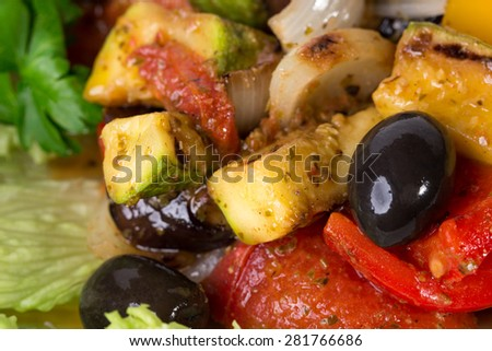Delicious grilled vegetables with olives. Macro. Photo can be used as a whole background. - stock photo