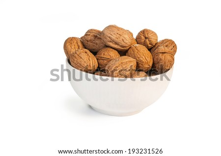 Delicious group of walnut in a glass bowl  - stock photo