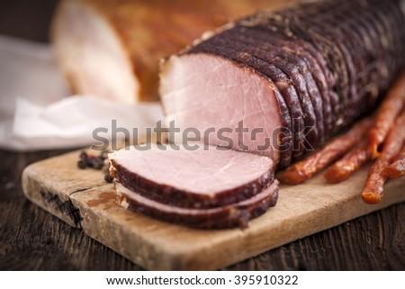 Delicious ham on wooden desk closeup, studio shot - stock photo