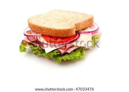 Delicious ham sandwich with whole wheat bread on white background