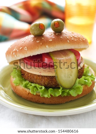 Delicious hamburger like a frog for kids party, selective focus - stock photo