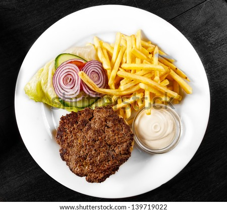 Delicious hamburger on white plate and table - stock photo