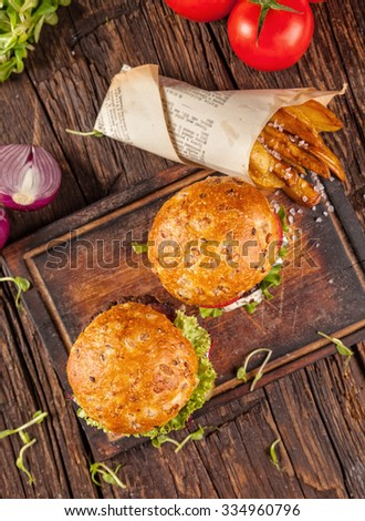 Delicious hamburger served on wooden planks. Shot from aerial view - stock photo