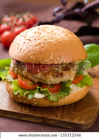 Delicious hamburger with a juicy beef patty,selective focus - stock photo