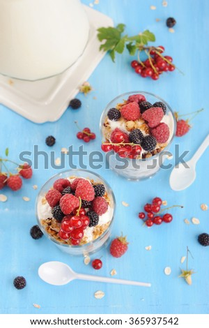 Delicious healthy cereal breakfast  with berries and granola - stock photo