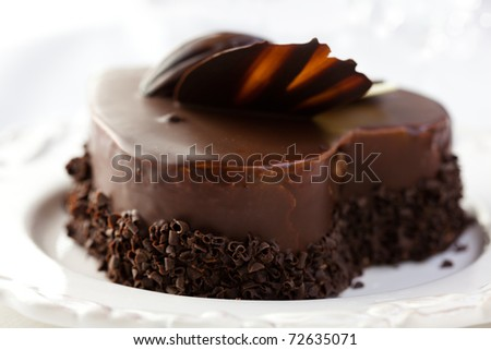 Delicious heart shaped chocolate cake - stock photo