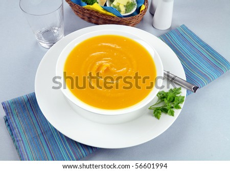 Delicious hearty homemade pumpkin soup ready to serve. - stock photo