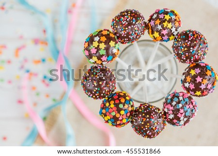 Delicious holiday colored cake pops in a glass. horizontal top view - stock photo