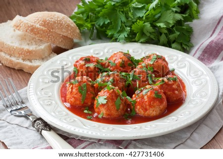 Delicious homemade chicken or turkey meatballs with rice, vegetable and tomato sauce/Meatballs with tomato sauce  - stock photo