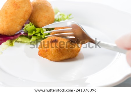 Delicious homemade croquettes on your plate with salad - stock photo