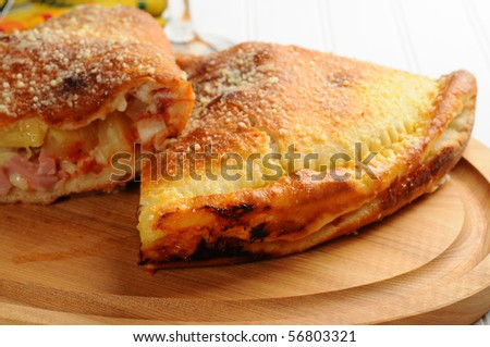 Delicious homemade panzarotti filled with cheese, ham and pineapple.