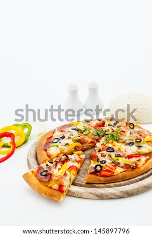 Delicious homemade pizza with ham and vegetables. - stock photo