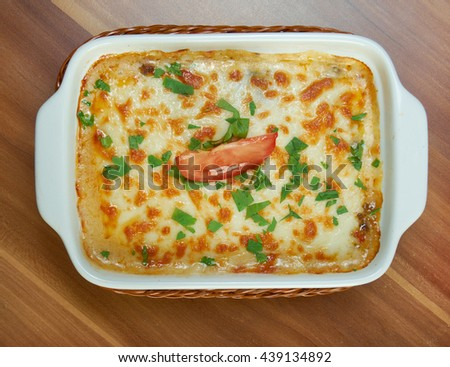 delicious homemade vegetable lasagna with tomato, paprika, onion and zucchini