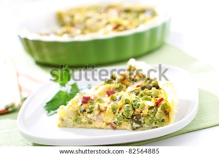 Delicious homemade vegetable pie with ham - stock photo