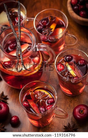 Delicious hot punch for winter and Christmas with fruits and wine - stock photo