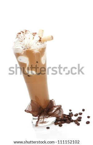 Delicious ice coffee with brown ribbon and coffee beans isolated on white. Refreshing summer drink. - stock photo
