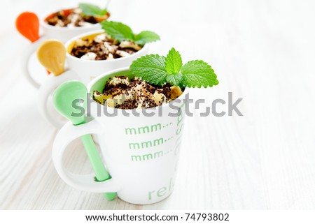 Delicious ice cream with colorful spoons and mint.