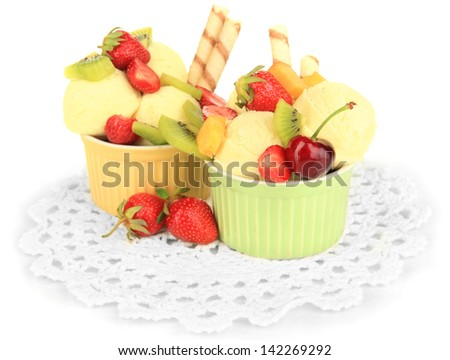 Delicious  ice cream with fruits and berries in bowl isolated on white