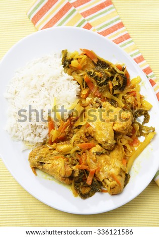 Delicious Indian chicken wings with rice, vegetables and curry sauce   - stock photo