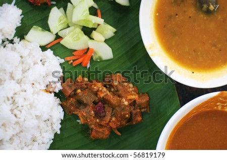 Delicious Indian cuisine spicy banana leaf rice - stock photo