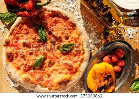 Delicious Italian pizza and roasted capsicums served on wooden table  Basic Roasted Capsicums recipe