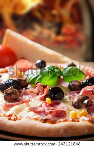 Delicious italian pizza served on wooden table, close-up.