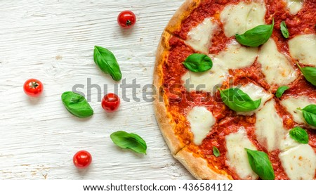 Delicious italian pizza served on wooden table, top view.