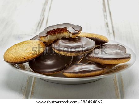 Delicious Jaffa Cakes. Cookies covered with dark chocolate and filled with orange marmalade. - stock photo