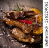 Delicious lamb chops on wooden table - stock photo