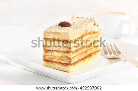 Delicious layered mocha and coffee cake served with an Italian coffee would look good on your menu, and tastes even better - stock photo