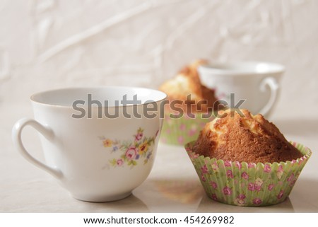 delicious lemon muffins with tea and coffee romantic mood - stock photo