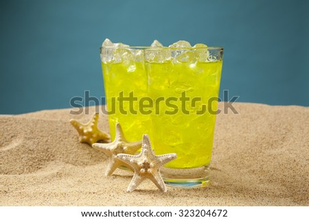Delicious lemonade on the beach - stock photo