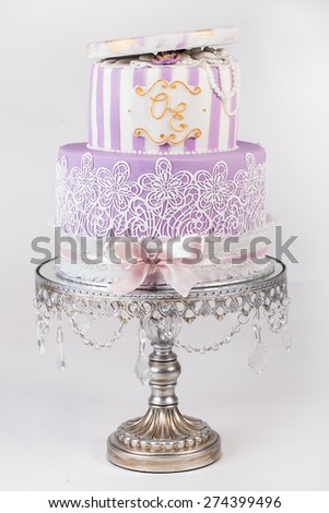 Delicious luxury white wedding or birthday cake decorated with cream colorful flowers