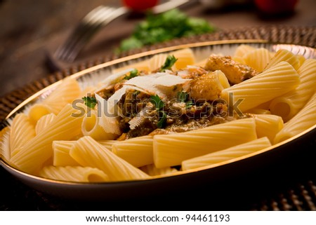 delicious macaroni pasta with sicilian pesto on wooden table