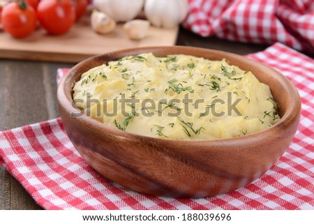 Delicious mashed potatoes with greens in bowl on table close-up - stock photo