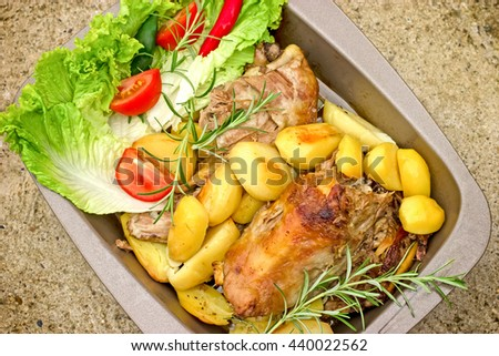 Delicious meal - roasted lamb with roasted potato - stock photo