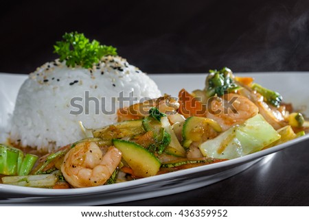 delicious meal with grilled shrimp and vegetables prepared and presented restaurant style with fresh ingredients - stock photo