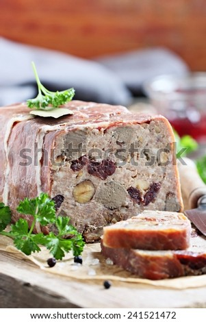 Delicious meat pate ( terrine) with liver,nuts and dried cranberry.Selective focus. - stock photo