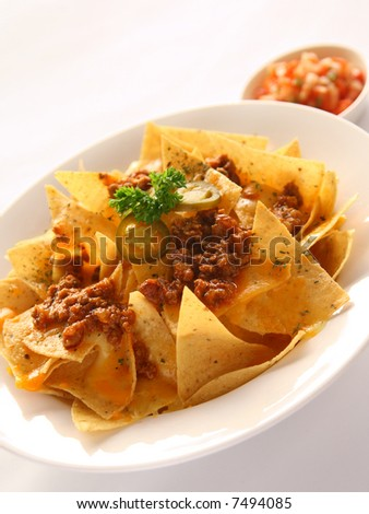 Delicious Mexican Nachoes appetizer - stock photo