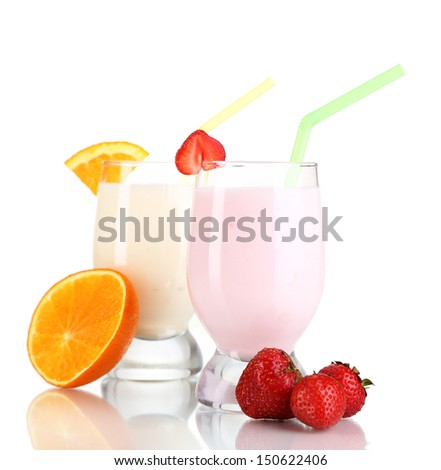 Delicious milk shakes with orange and strawberries isolated on white