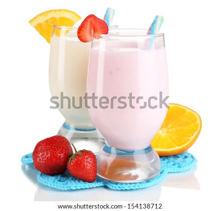 Delicious milk shakes with orange and strawberries isolated on white - stock photo