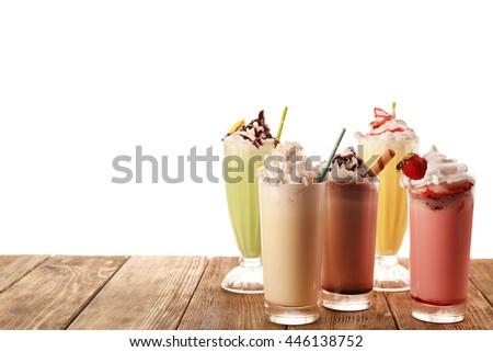 Delicious milkshakes, isolated on white - stock photo