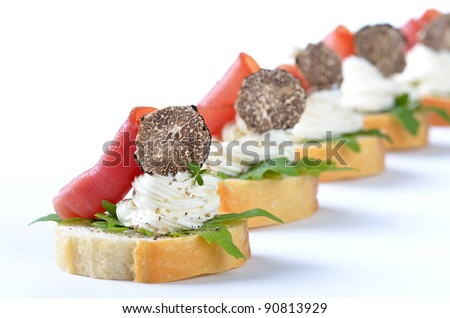 Delicious morsels with cream cheese, ham and Italian truffles - stock photo