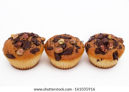 Delicious muffins with chocolate and hazelnut, isolated on white  - stock photo