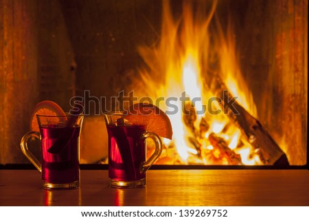 delicious mulled wine at romantic fireplace firelight only - stock photo