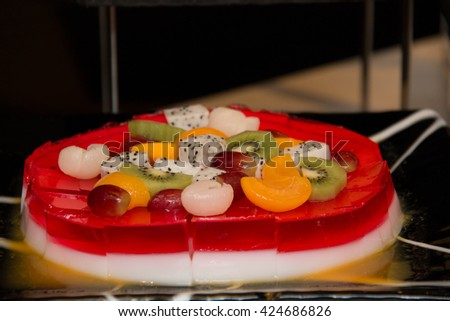 Delicious multi - layered fruit jelly made from  fresh fruit and slice 